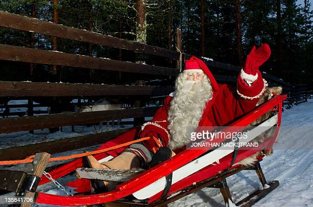 Santa Claus rides a reindeer and sled outside Rovaniemi, Finnish Lapland on December 15, 2011. AFP PHOTO/JONATHAN NACKSTRAND