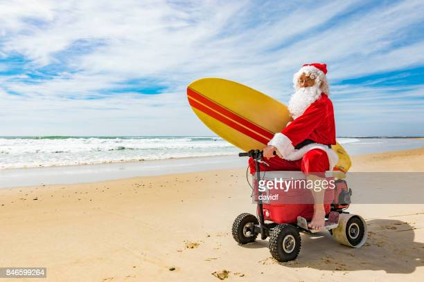 Santa Claus Riding a Motorised Esky Cooler on the Beach