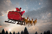 Santa Claus riding on sleigh with gift box