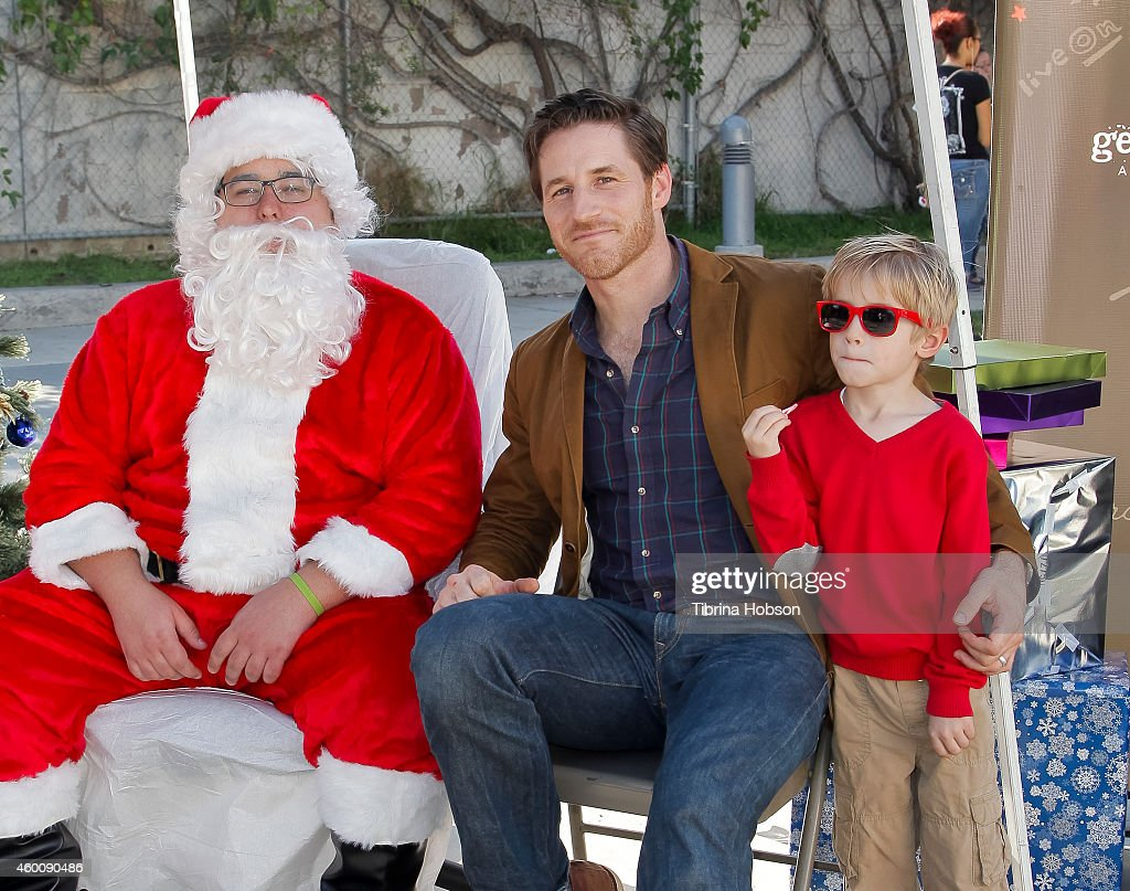 Santa Claus, Sam Jaeger and his son Gus Jaeger attend the