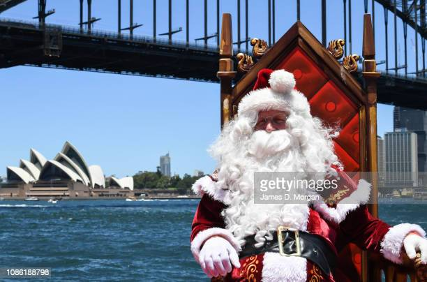 Santa Claus sits in his chair as he poses for photographs at Luna Park on December 24 2018 in Sydney Australia Hundreds of locals and international...