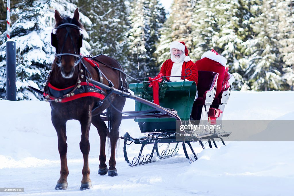 Santa Claus sitting in His Sleigh : Stock Photo
