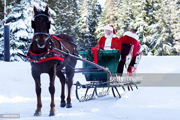 santa claus sitting in his sleigh - carriage stock pictures, royalty-free photos & images