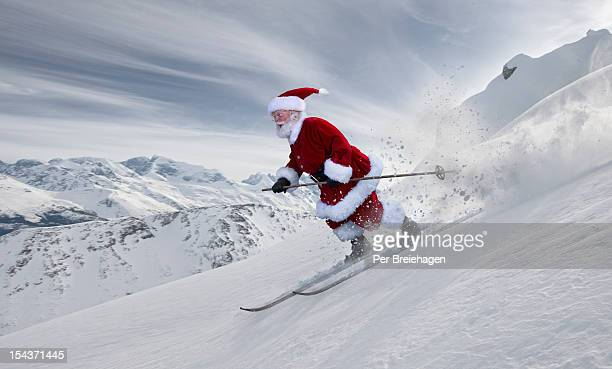 Santa Claus skiing in the big mountains