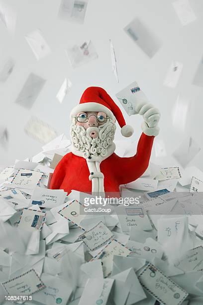 Santa Claus snowing letters