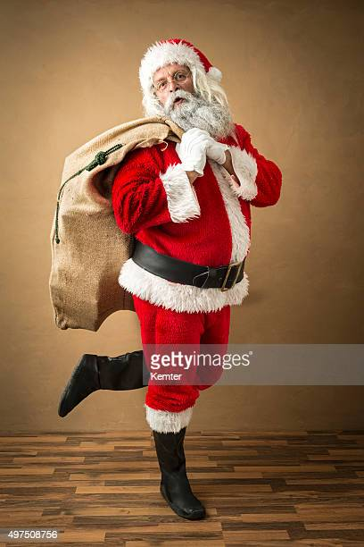 santa claus standing on only one leg