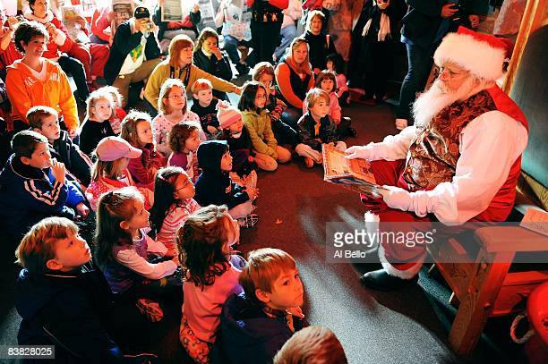 Santa Claus student Tom Carmendy of Westminster Colorado dresses up as Santa Claus and reads a Christmas story for a group of elementary school...