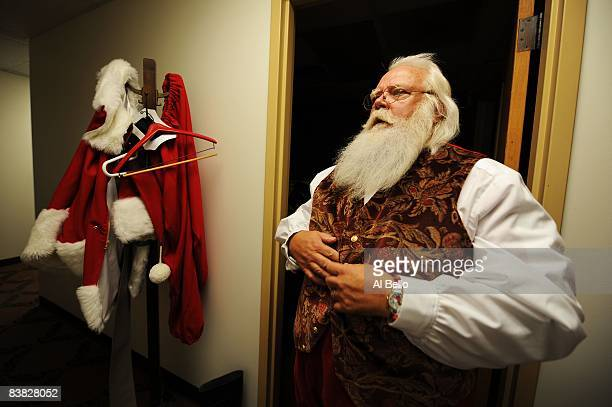 Santa Claus student Tom Carmendy of Westminster Colorado puts on his Santa Claus suit prior to performing for a group of elementary school children...