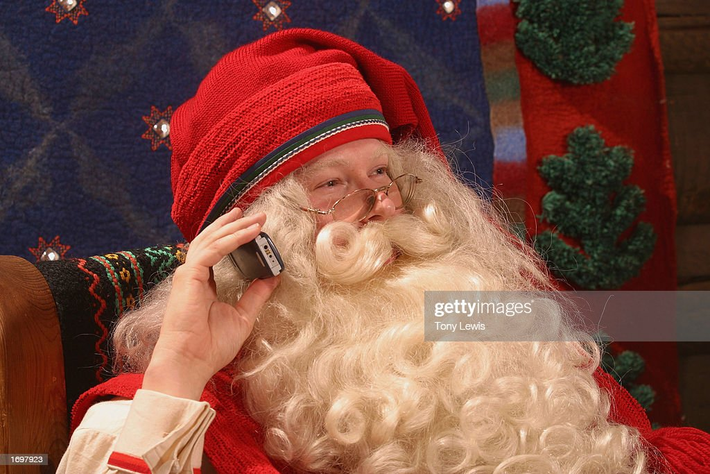 Santa Claus Takes A Call On His Mobile Phone : News Photo