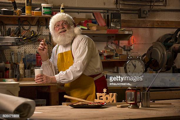 santa claus taking a break from working in his workshop - santas workshop stock photos and pictures