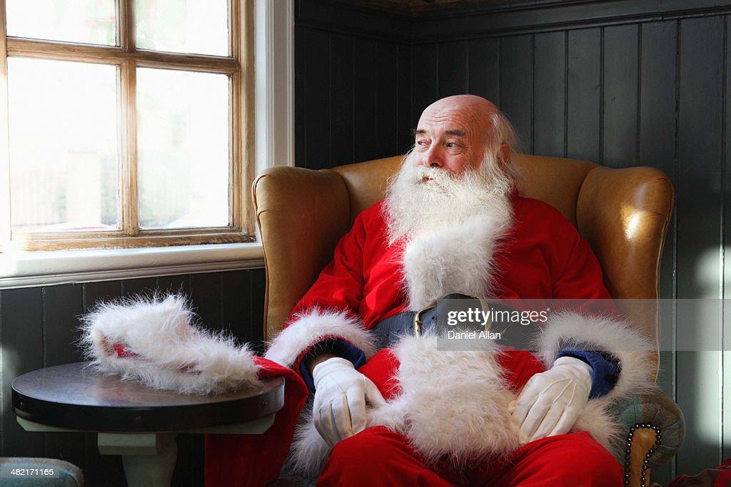 Santa Claus taking break in armchair : Stock Photo