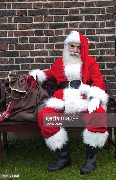Santa Claus taking break on bench