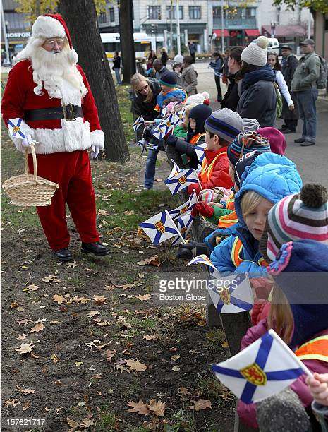 Santa Claus talks to children from the Spruce Street Nursery School who came to see the christmas tree arrive The official 2012 Christmas tree will...