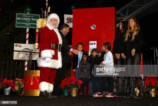 Santa Claus Texas Motor Speedway President Eddie Gossage and the Great American Sweethearts get ready to light the tree with the help of some child...