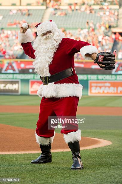 Santa Claus throws out a ceremonial first pitch as part of a 'Christmas in June' promotion before the game between the Oakland Athletics and the Los...