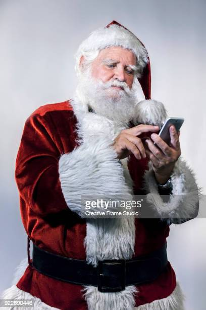 Santa Claus using and dialing a smartphone