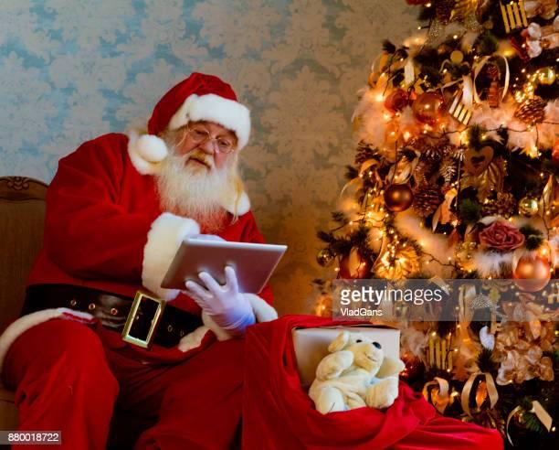 Santa Claus using digital tablets