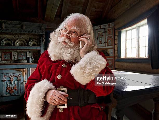 Santa Claus using his smart phone
