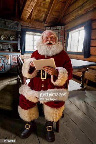 Santa Claus using his tablet computer