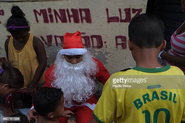 Santa Claus visits the Favela da Mare North Zone of the city and distributes gifts to the children