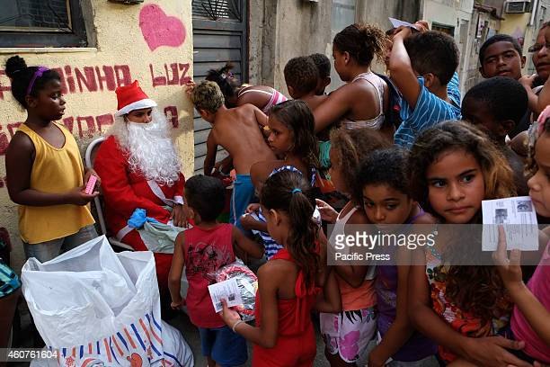 Santa Claus visits the Favela da Mare, North Zone of the city, and distributes gifts to the children.
