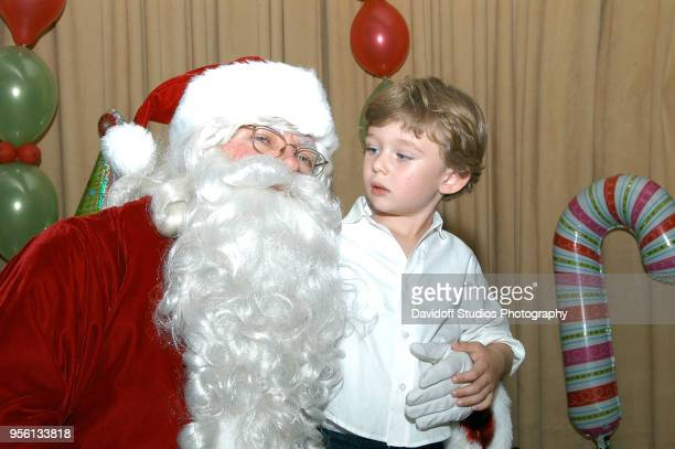 Santa Claus visits with Barron Trump son of Donald Trump at the MarALago estate Palm Beach Florida December 25 2008