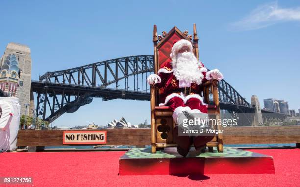 Santa Claus waits for customers in the hot summer sunshine at Luna Park on December 13 2017 in Sydney Australia Luna Park has pulled some strings in...