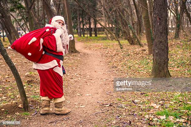 Santa Claus walking with the bag of the presents