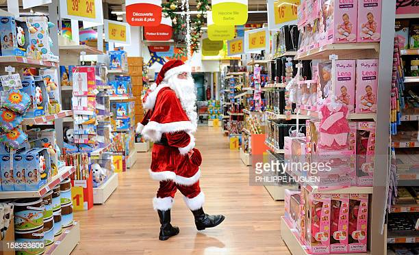 A Santa Claus walks through a toy store in Lille northern France on December 15 2012 AFP PHOTO / PHILIPPE HUGUEN