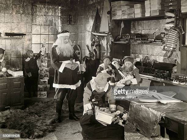 Santa Claus Watching over Elves in Workshop