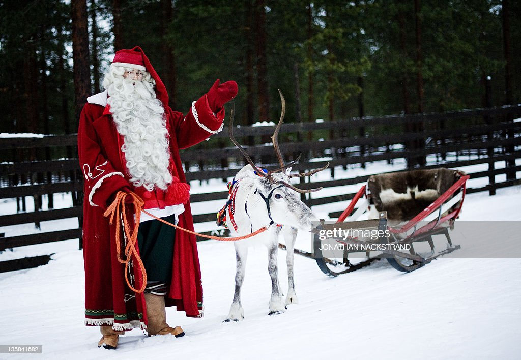 Santa Claus waves as he stands with  a r : News Photo