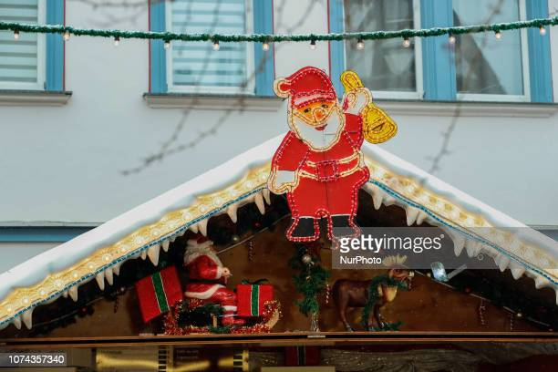 Santa Claus with a Christmas Bell Christmas Market in the Northern Bavarian town of Forchheim It snowed heavily but a lot of people visited the...