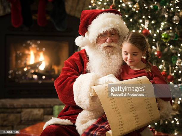 santa claus with a little girl on his lap