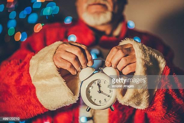 Santa Claus with alarm clock