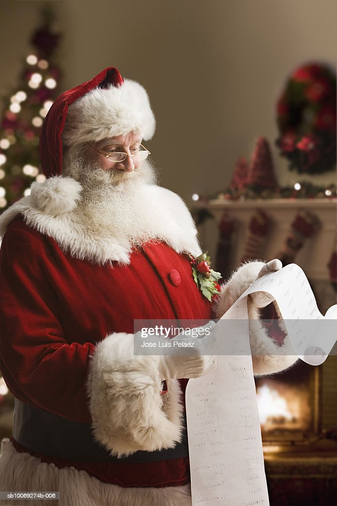 Santa Claus with checklist, close-up : Stockfoto