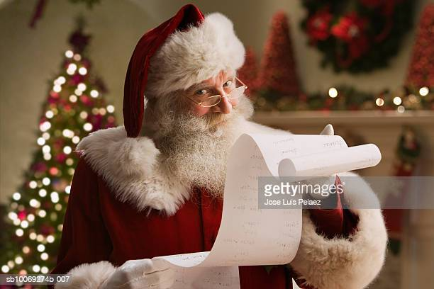 santa claus with checklist, portrait, close-up - list stock pictures, royalty-free photos & images