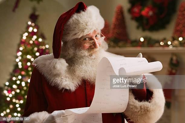 Santa Claus with checklist, portrait, close-up