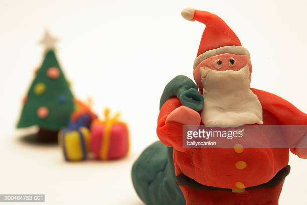 Santa Claus with christmas tree and gifts