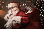 Santa Claus with finger on the lips
