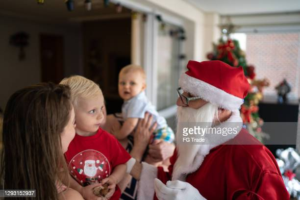 santa claus with kids at home - religious equipment stock pictures, royalty-free photos & images