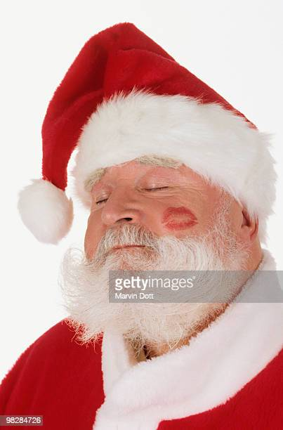 Santa Claus with lipstick mark on cheek