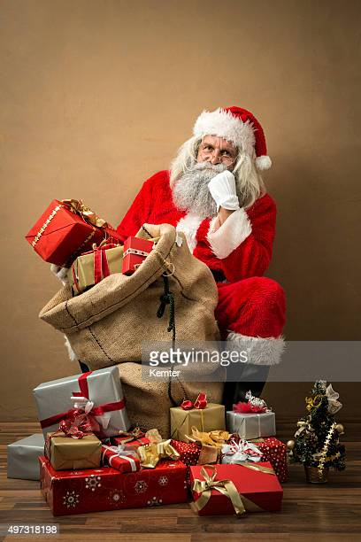 santa claus with many gifts in his bag