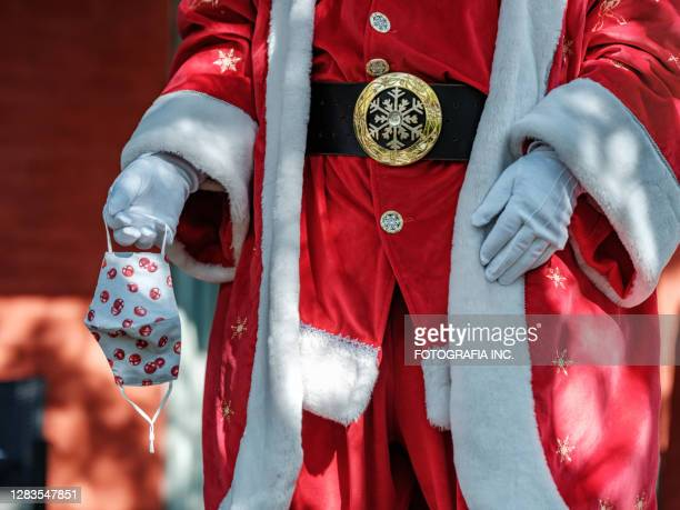 santa claus with mask outdoors - father christmas stock pictures, royalty-free photos & images