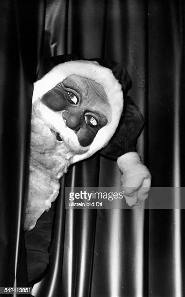 Santa Claus with mask Photographer Charlotte Willott 1957Vintage property of ullstein bild