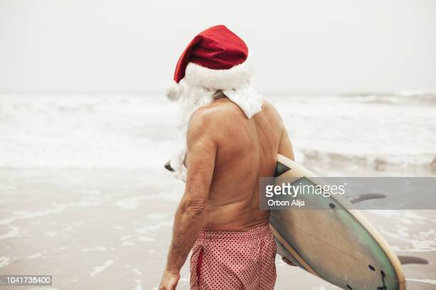santa claus with surf board - mexican christmas stock photos and pictures