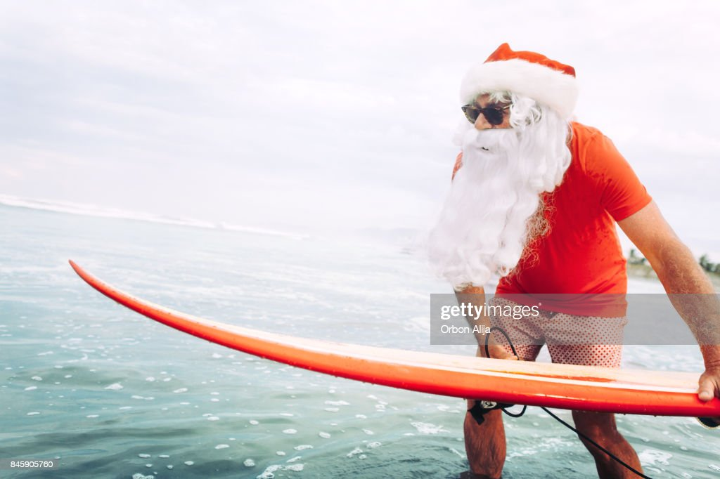 Santa Claus with surf board : Stock Photo