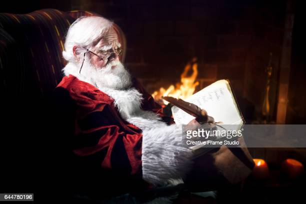 Santa Claus working by the fireplace.