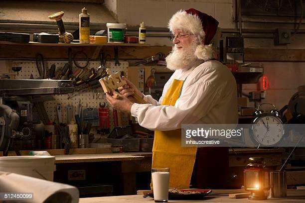 Santa Claus working in his workshop