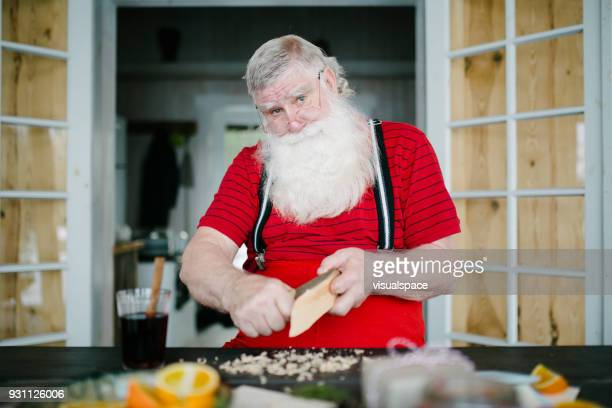 santa claus working in his workshop - santas workshop stock photos and pictures