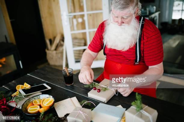 Santa Claus wrapping presents